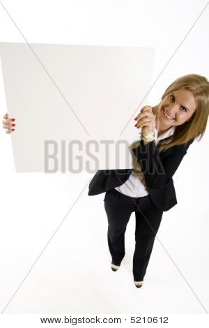 Wide Angle Picture Of An Attractive Businesswoman Presenting A Blank Board