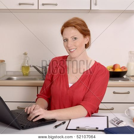 Pretty Red-haired Woman Working In Her Home Office