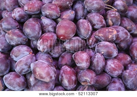 Violet plum fruits