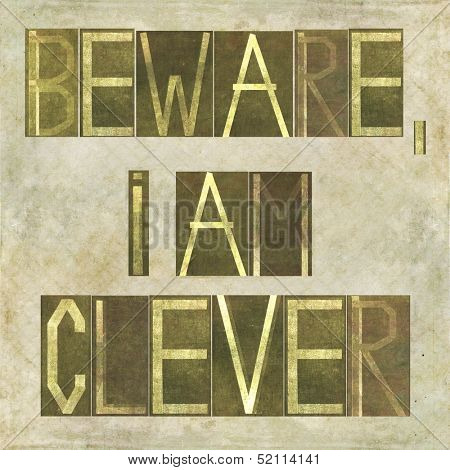"Earthy background image and design element depicting the words ""Beware, I am clever"""