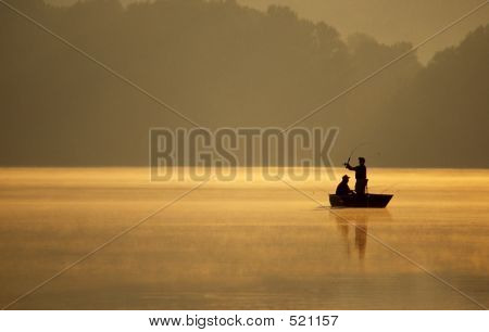 Anglers Fishing On Lake