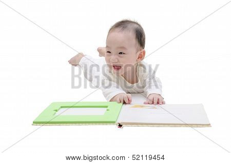 Cute baby is reading