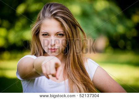 You - teen girl pointing with finger