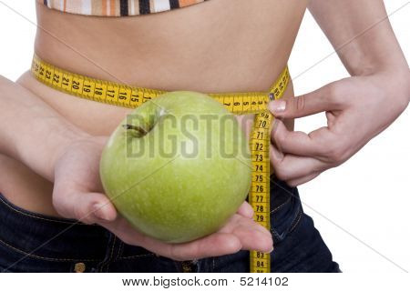 Waist Is 65.5 Centimeters. Fit Woman With Measure Tape And Apple.