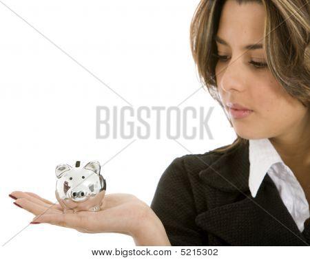 Woman looking at ein Sparschwein