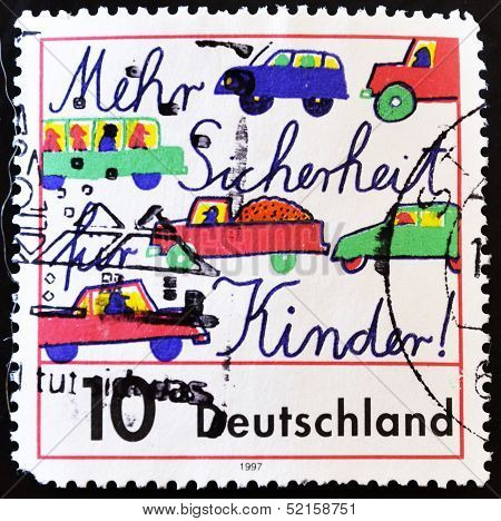 stamp showing a picture of cars by children with the message for the children safer