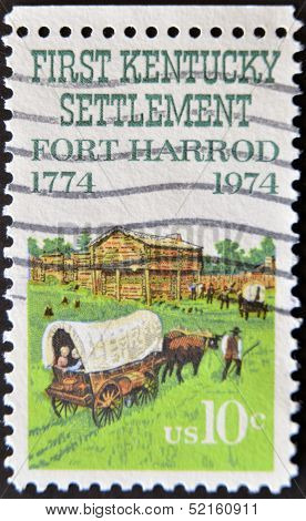 a stamp printed in the United States of America shows Fort Harrod the first Kentucky settlement west
