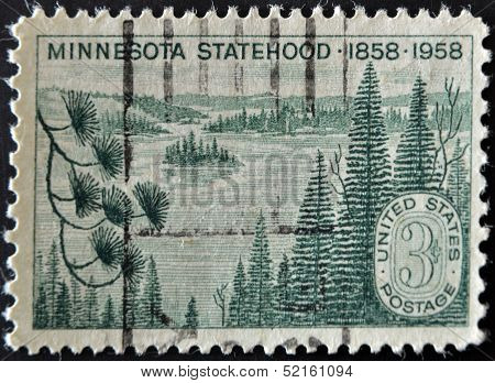 United States Of America - Circa 1958:  A Stamp Printed In Usa Shows Minnesota Lakes And Pines