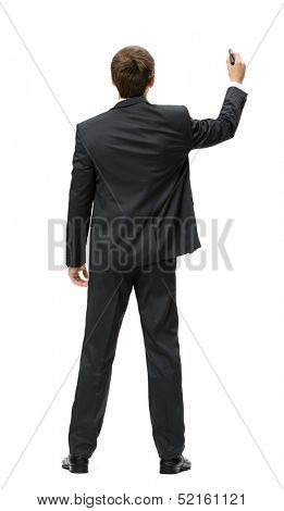 Full-length backview of businessman writing with marker on imaginary screen, isolated on white. Concept of leadership and success