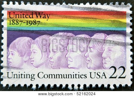 A stamp printed in the USA shows image of Americans of different races united way
