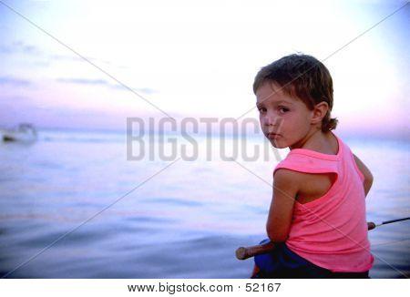 BOY FISHING ON DOCK