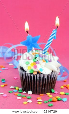 Birthday Party Chocolate Cupcake With Candle And Star Lit.  Copy Space Available.