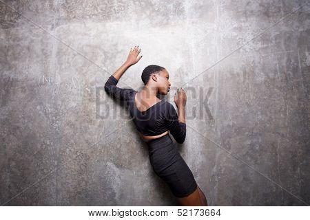 Woman posing on a concrete wall