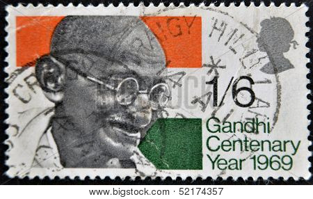 A Stamp Printed In The Great Britain Shows Mahatma Gandhi And Flag Of India