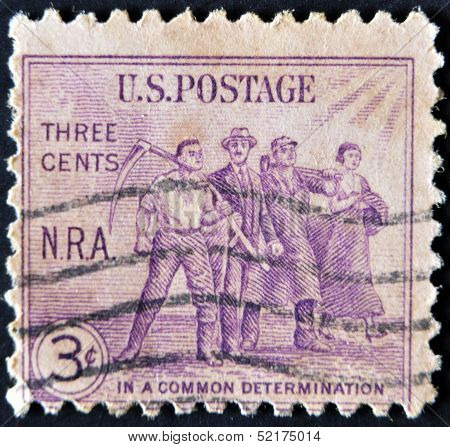 A stamp printed in the USA shows Workers: National Recovery Act (N.R.A.) In a common determination