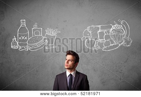 Young businessman choosing between healthy and unhealthy foods