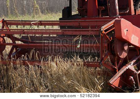 Treierand Threshing Grain On The Field