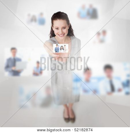 Smiling attractive woman catching a picture on blurred background