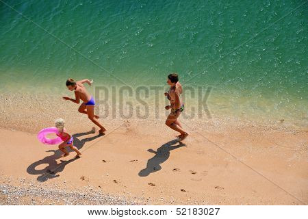 family play on a beach