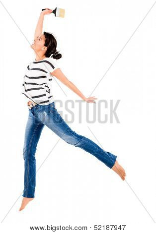 Excited woman painting with a brush - isolated over white background