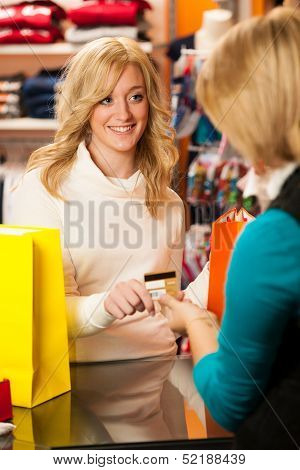 Cute Young Woman Paying After Succesfull Purchase With Credit Card