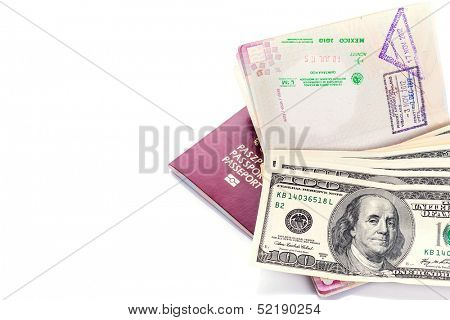Two passports with American dollars and visa stamps