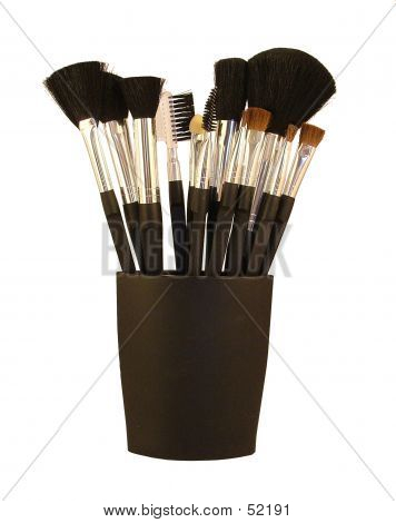 A Set Of Make Up Brushes In A Black Holder