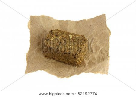 A cube of Traditional Chinese herbal tea soup (Medicinal herbal tea) containing many parts of plants, to treat indigestion