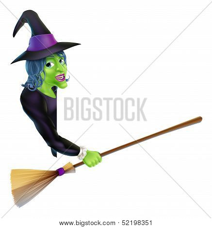 Halloween Witch Pointing With Broom