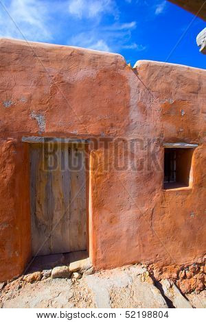 Ibiza grunge orange facade in Benirras beach at Balearic Islands Spain