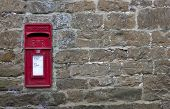 stock photo of mailbox  - Post box set into stone wall - JPG