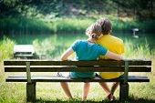 lovely young couple sitting on seat bench
