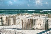 stock photo of breaker  - Beautiful landscape or seascape of white sand beaches puffy clouds cheerful sand fences and emerald tropical waves with frothy breakers on a sunny day at Pensacola Florida beach - JPG
