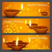 stock photo of deepavali  - illustration of burning diya on Diwali Holiday banner - JPG