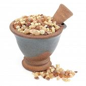 foto of pestle  - Frankincense and myrrh in a mortar with pestle over white background - JPG
