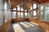 pic of screen-porch  - Large wooden porch with lake view in luxury home - JPG