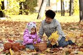 Grandmother and granddaughter in the autumn park