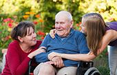 foto of grandfather  - The female generation visiting old grandfather at the nursing home - JPG