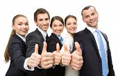 stock photo of cheer-up  - Group of thumbing up business people - JPG