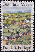 A stamp printed by United States of America shows the 4th of July by Grandma Moses