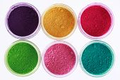 stock photo of pigment  - Colorful pigments powders isolated on white background - JPG