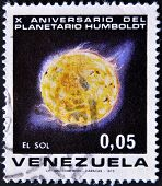 A stamp commemorating the tenth anniversary of the Humboldt Planetarium shows the sun