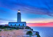 image of mola  - La Mola Cape Lighthouse Formentera at sunrise in Balearic Islands - JPG