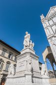 stock photo of alighieri  - Statue of Dante Alighieri located in the Piazza di Santa Croce in Florence Italy