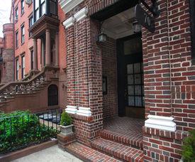 stock photo of brownstone  - Daytime shot of brick entryway in brownstone neighborhood of Brooklyn - JPG
