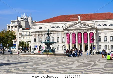 LISBON, PORTUGAL - MARCH 17: Main facade of the National Theatre Dona Maria II on March 17, 2014 in Lisbon, Portugal. The theater is located in the Rossio Square, in the heart of Lisbon