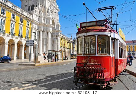 LISBON, PORTUGAL - MARCH 17: Old tram in the Praca do Comercio on March 17, 2014 in Lisbon, Portugal. Tram is the traditional form of public transport in Lisbon