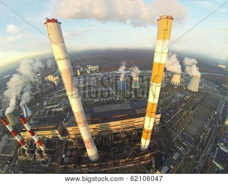 Big territory of power plant with many different chimneys at winter day. Aerial view