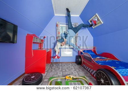 Father with daughter in children room at inverted house