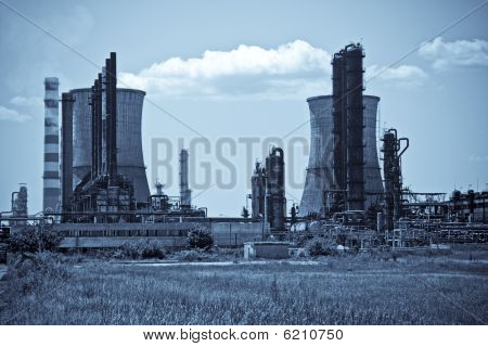 Industrial Towers At Oil Refinery